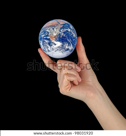 Planet earth in fingers.Elements of this image furnished by NASA