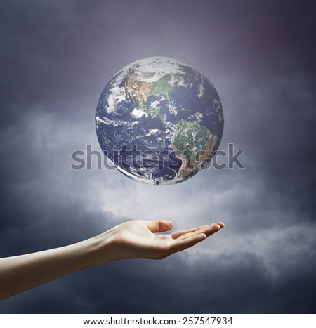 Planet earth in hands. Elements of this image are furnished by NASA - stock photo