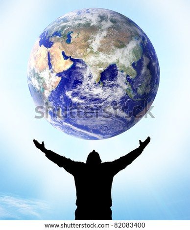 Planet Earth in human hand - stock photo
