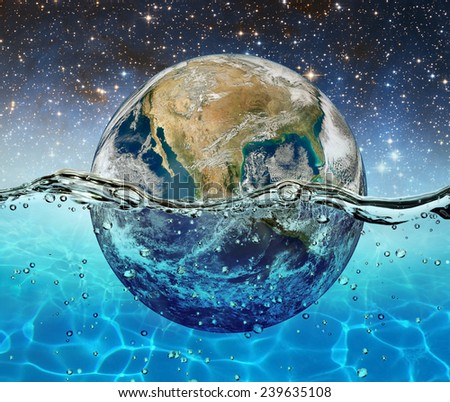 Planet Earth is submerged in water on the background of the starry sky. Elements of this image furnished by NASA (http://www.nasa.gov/) - stock photo