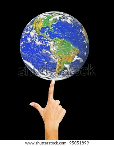 Planet Earth on finger.Elements of this image furnished by NASA - stock photo