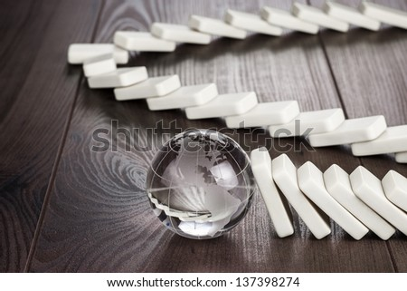 planet Earth standing still concept on wooden table - stock photo