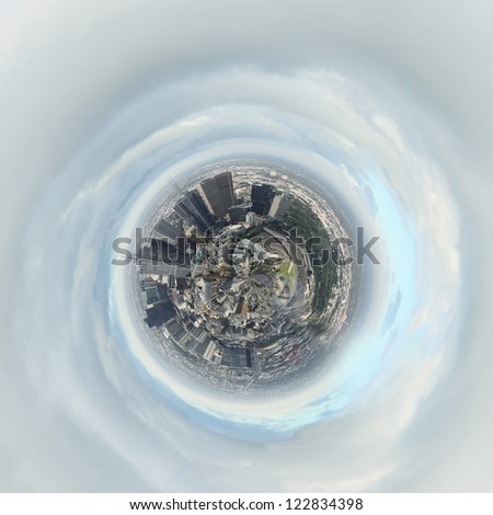 Planet earth with city on it against sky background - stock photo