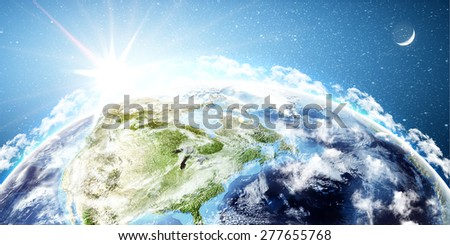 Planet Earth with rising sun - Elements of this image furnished by NASA