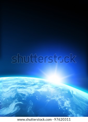 Planet Earth with Rising sun with room for text or copy space. - stock photo