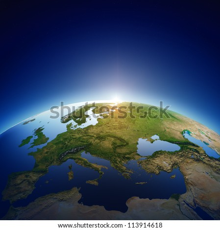 Planet earth with sun rising over European countries (Elements of this image furnished by NASA- earthmap  http://visibleearth.nasa.gov) - stock photo