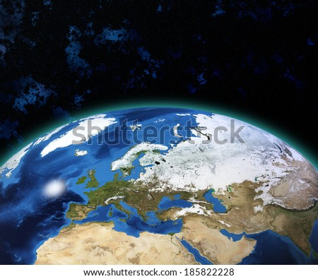 Planet Earth with sun rising over European countries (Elements of this image furnished by NASA) - stock photo