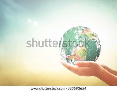Planet in human hands. Ecology World Environment Day Investment CSR Earth Hour Peace Health Care Eco Friendly Trust Give Offer Help Life Energy Search concept. Elements of this image furnished by NASA - stock photo