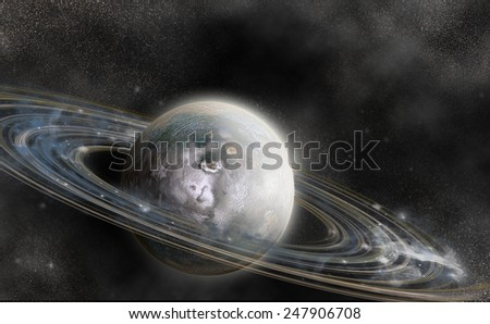 Planet in space with numerous prominent ring system - stock photo