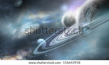 Planet in space with numerous prominent ring system and three moons orbit the planet - stock photo