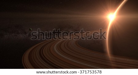 planet saturn with rings at sunrise on the space background. Elements of this image furnished by NASA - stock photo