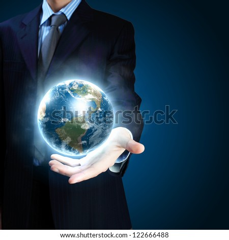 Planet System in Your Hand. Conceptual Image. Elements of this image furnished by NASA.