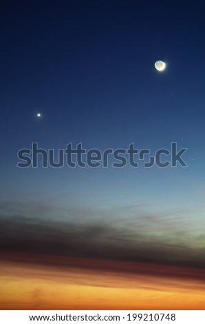Planet Venus and Moon in a dusk sky - stock photo