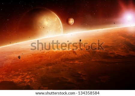 planets at sunrise in outer space. - stock photo