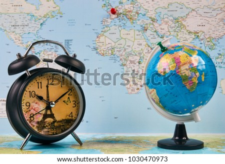 Planing travel france paris worldmap globe stock photo royalty free planing for travel to france paris with worldmap globe and alarm clock travel time in gumiabroncs Images