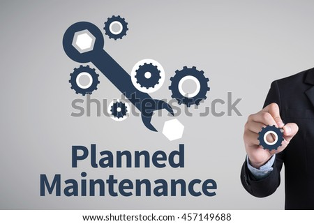 Planned Maintenance Businessman hand writing with black marker on white background
