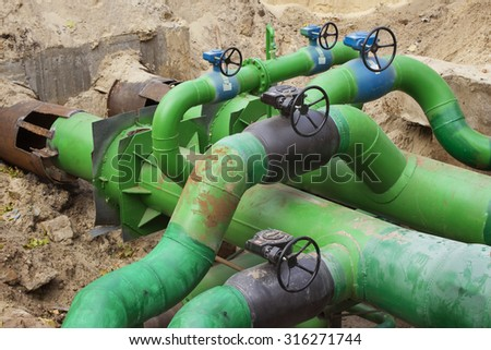 Planned repairs of municipal tubing. A node with valves. - stock photo
