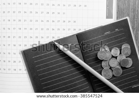planner and money with black and white concept - stock photo