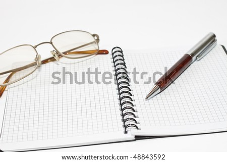 planner, pen and glasses on white background
