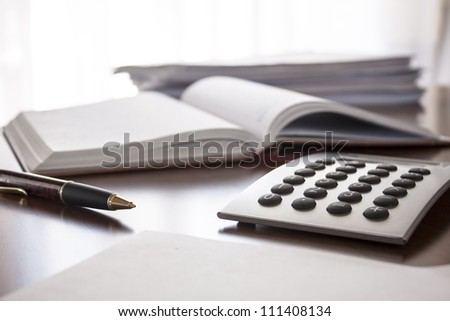 planner with  pen and calculator on the table - stock photo