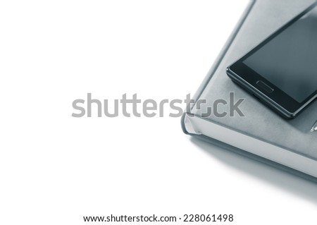 Planner with phone on a white background isolate - stock photo