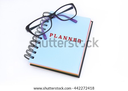 PLANNER word in blue notepad with white background - stock photo