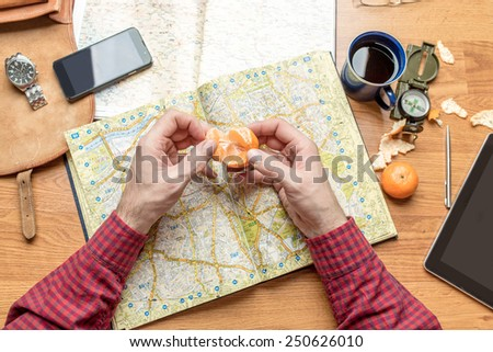 Planning a travel destination, focus on hands - stock photo