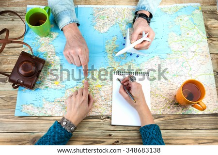 Planning a trip to Amsterdam Holland. Young couple adventurous. Travel agency chooses the tour desk. top view - stock photo
