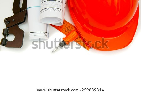 Planning of construction of the house. Drawings for building house, helmet and other working tools.  - stock photo