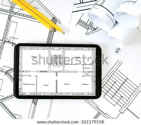 Planning of construction of the house. Tablet, drawings and working tools.
