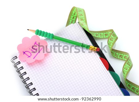 Planning of diet. Notebook measuring tape and pencil isolated on white - stock photo