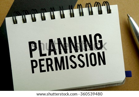 Planning permission memo written on a notebook with pen