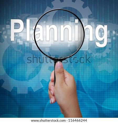 Planning, word in Magnifying glass; business background - stock photo