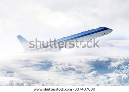 Plano flying to the clouds - Elements of this image furnished by NASA - stock photo