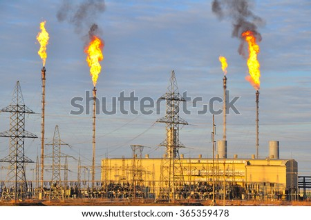 Plant flare stacks - stock photo