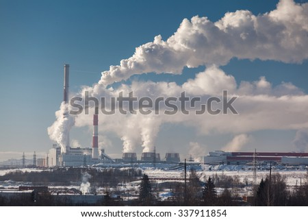 Plant with smoke at winter sunny day