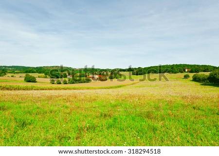 Plantation of Corn near the Small Village in France - stock photo