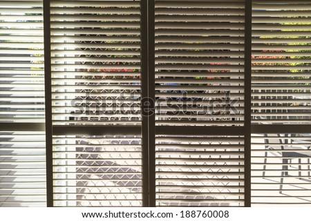 Plantation style elegant shutters window treatment for stylish home  - stock photo