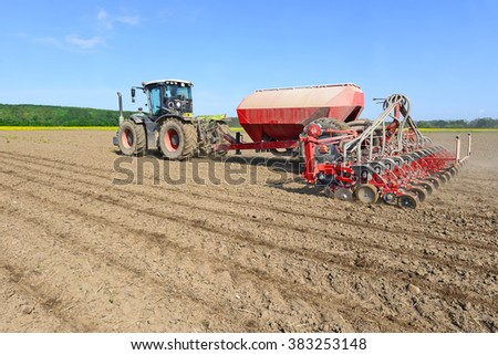 Planting corn trailed planter in the field  - stock photo