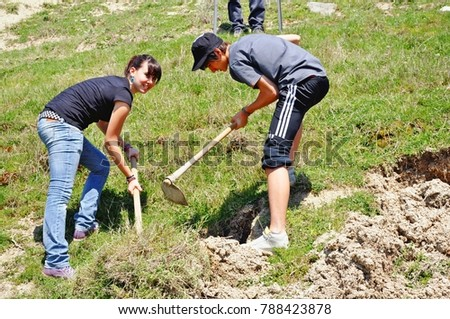 Planting of trees by school students under mountain Olympus. Sparmos village, Thessaly region, central Greece, April 22 2010.