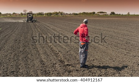 Planting soybean on field