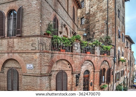 plants on a balcony in an old building in Certaldo, Italy - stock photo