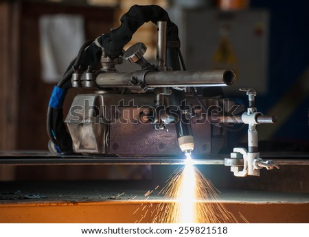 Plasma cutting process of metal material with sparks - stock photo