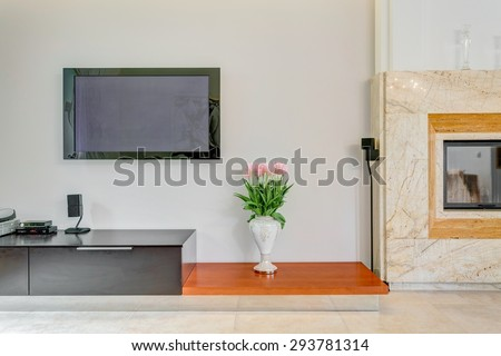 Plasma TV on the wall in living room - stock photo