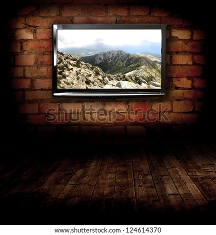 Plasma TV on the wall with possitive picture - stock photo