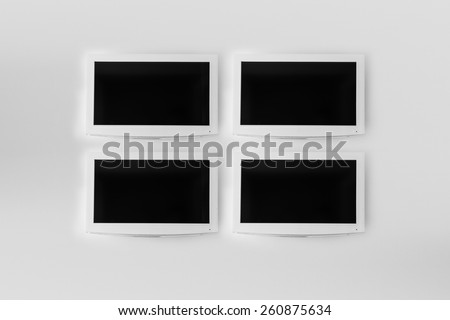 Plasma TV on the white wall of the room - stock photo