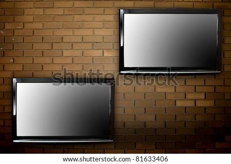 Plasma TVs on the wall - stock photo