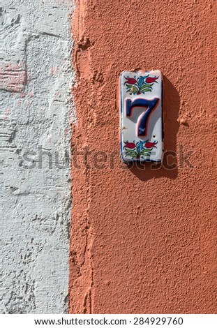 plaster and house number - stock photo