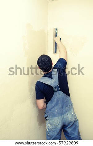 plaster at work - stock photo