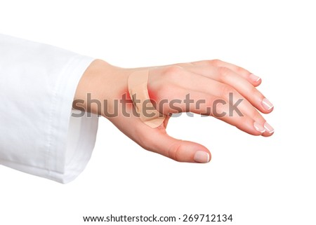 Plaster bandage on injured skin - stock photo